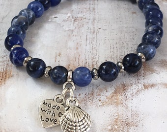 Bracelet of blue Sodalite with two silver-plated charms, with heart and shell charms, gift for sea lovers, gift for her