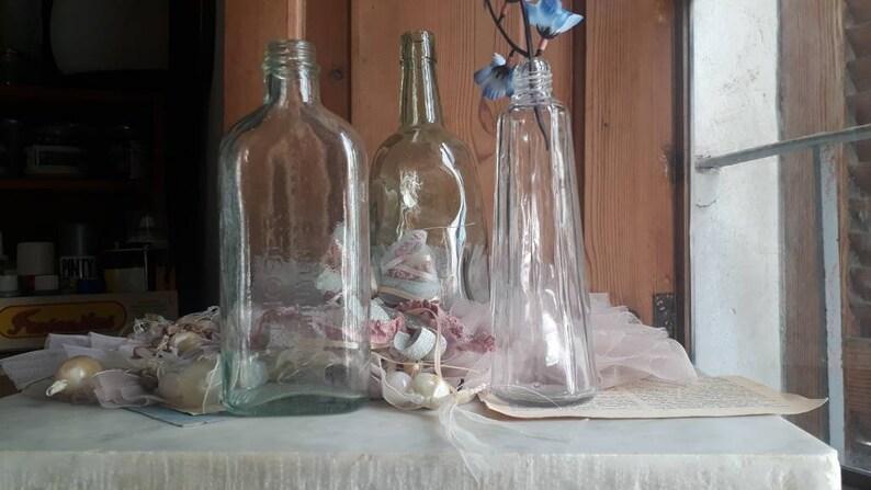 Old pharmacy bottle Vintage decorative bottle Vintage transparent glass bottle. Ancient and rare glass bottle