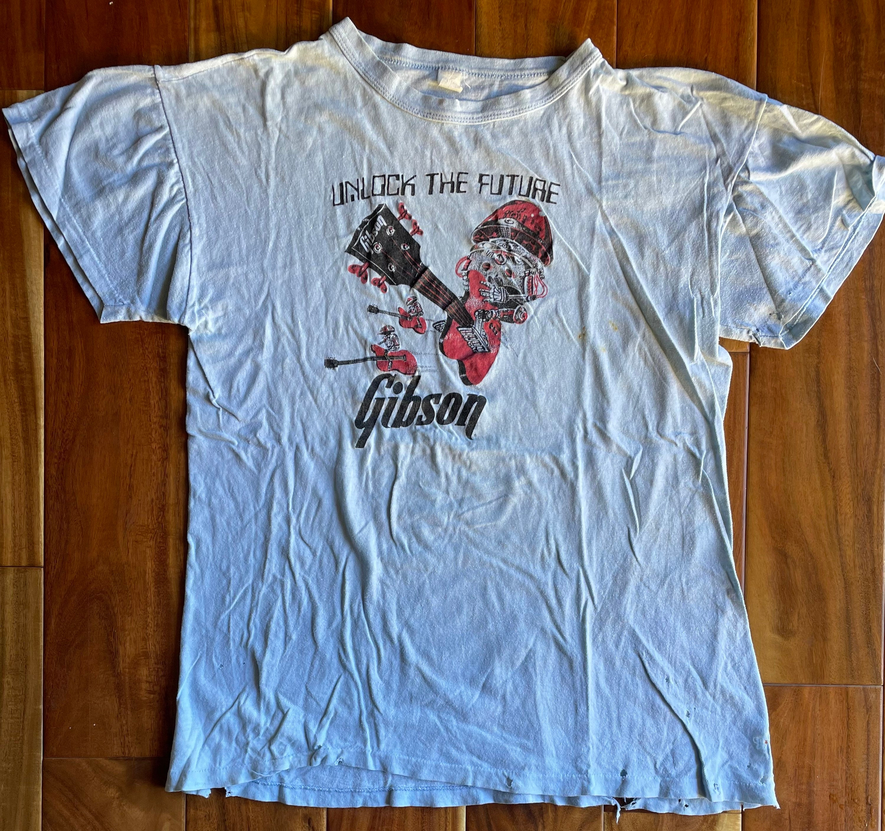 1970s Mens Shirt Styles – Vintage 70s Shirts for Guys Distressed Gibson Unlock The Future Tee, 1970S $0.00 AT vintagedancer.com