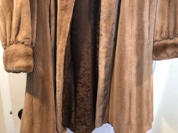 Sheared mink swing coat.