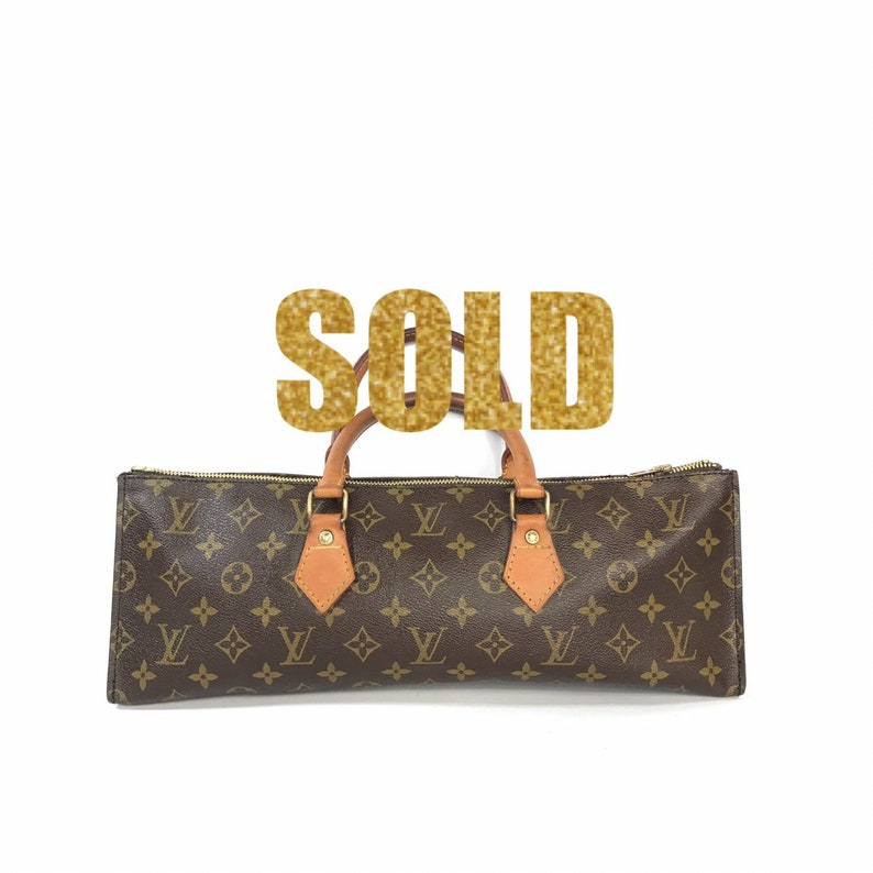 f7b13436753a LOUIS VUITTON Vintage Sac Triangle Browns Monogram Canvas and