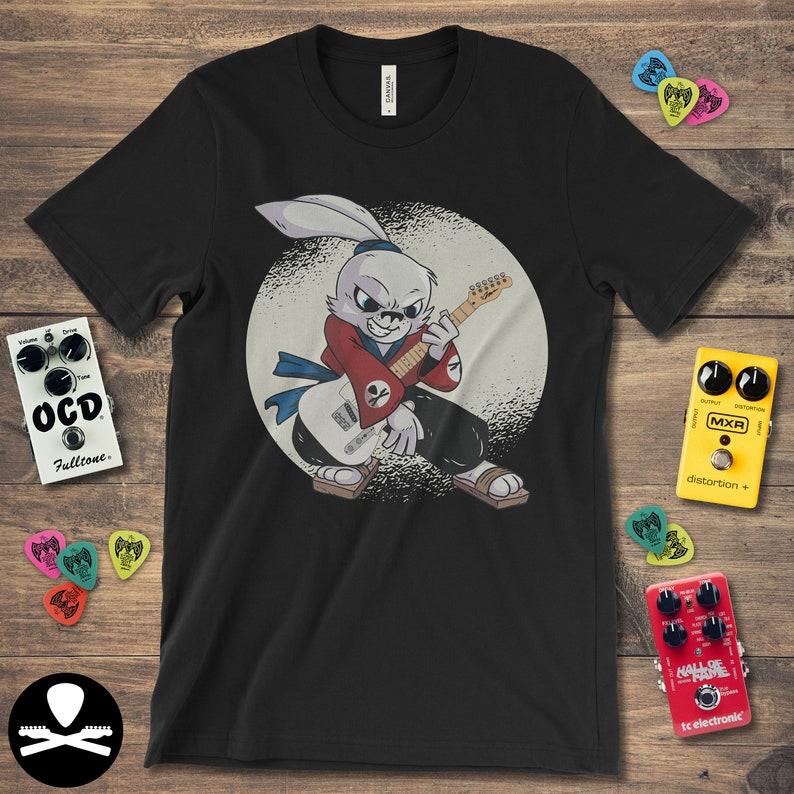 Hayate the Samurai Rabbit Guitarist holding a Telecaster image 0