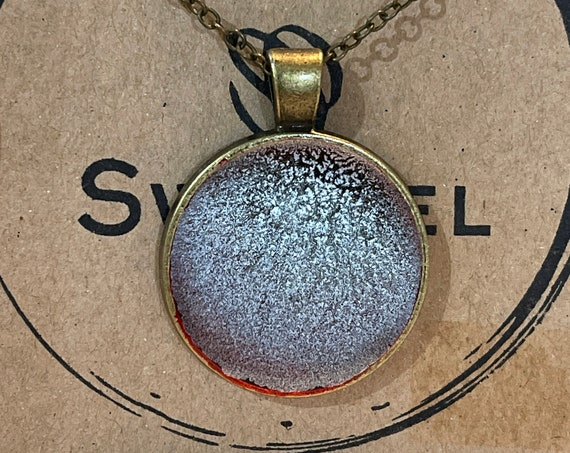 One of a Kind Resin Art Necklace in Silver with a hint of Red Antique Bronze Circle Pendant