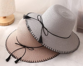 98b443f3ed9 Fashion women sun hats    female foldable wide brim leather belt tassel straw  hat    casual woman summer shade beach hat