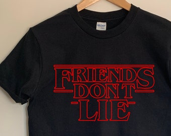 12569f600e5f Friends Don't Lie Stranger Things text inspired adults unisex tshirt