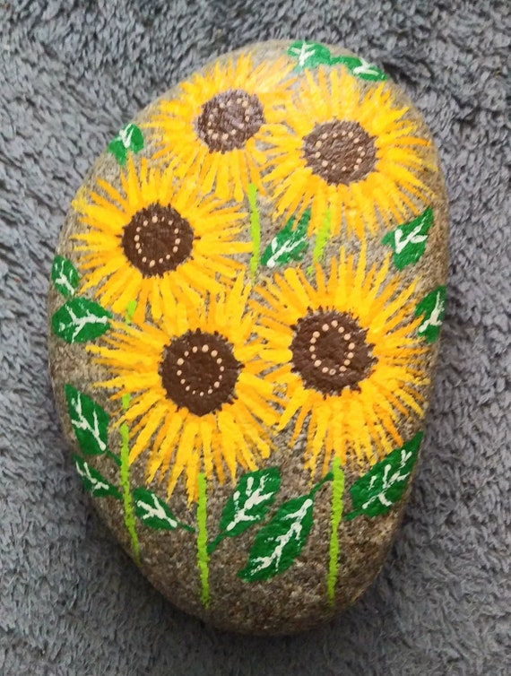 Handpainted flowers on river rock