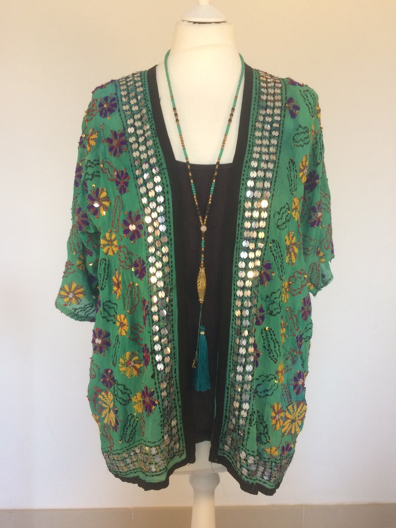 1920s Coats, Furs, Jackets and Capes History Boho Party JacketHippie Party JacketBoho TopHippie TopFestival topBoho cover upHippie kimonoParty kimonoBoho Summer cardigan $92.90 AT vintagedancer.com