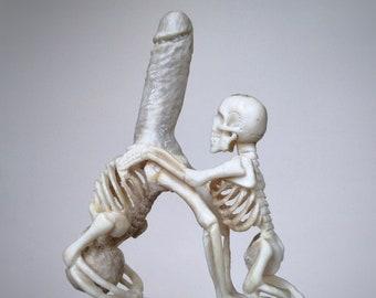 Carved skeleton figurine with penis of deer antler