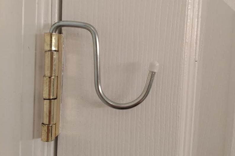 The HINGE BUDDY  Sold in Pairs  No Damage Space Saver   So image 0