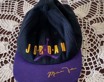 6ca63c35d64 Vintage Nike Air Jordan Purple and Black Cap Signed by Michael Jordan Made  in USA 1990 s