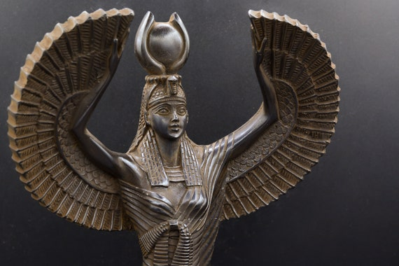 statue of the Egyptian goddess Isis open-winged  made in Egypt