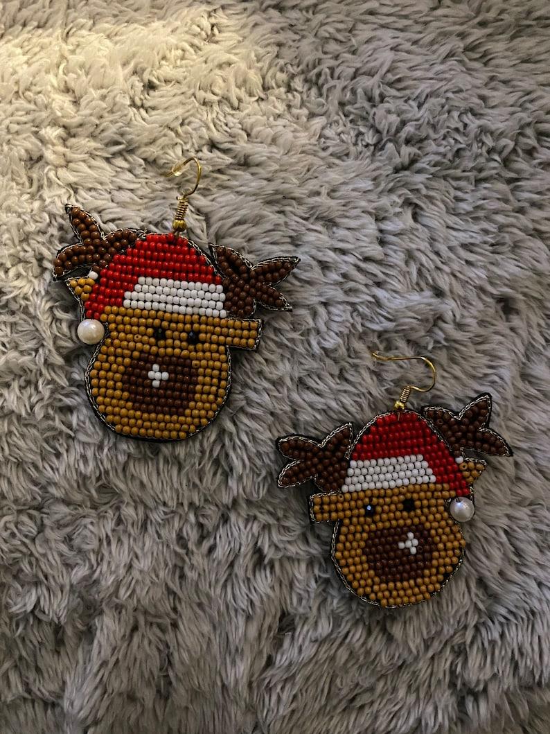 Reindeer with hat earrings