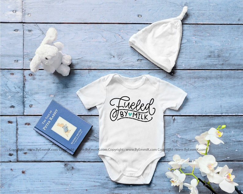 fueled by milk svg baby boy svg funny baby svg baby girl svg baby onesie svg instant download file for cricut and silhouette.