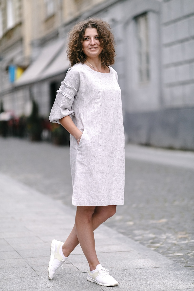 side seam pockets and vents 100/% European linen dress Brighton knee-length 34 length sleeves with a little ruffle Generous fit