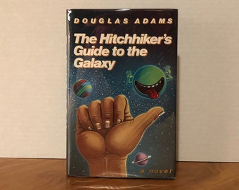 The Hitchhiker's Guide to the Galaxy by DOUGLAS ADAMS - 1st Edition, 16th Printing
