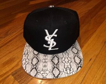 f584ba86c4d YSL inspired custom embroidered snapback hat (Black w  White snakeskin brim)