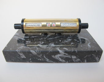 Ephemerides or ancient calendar with grey marble base