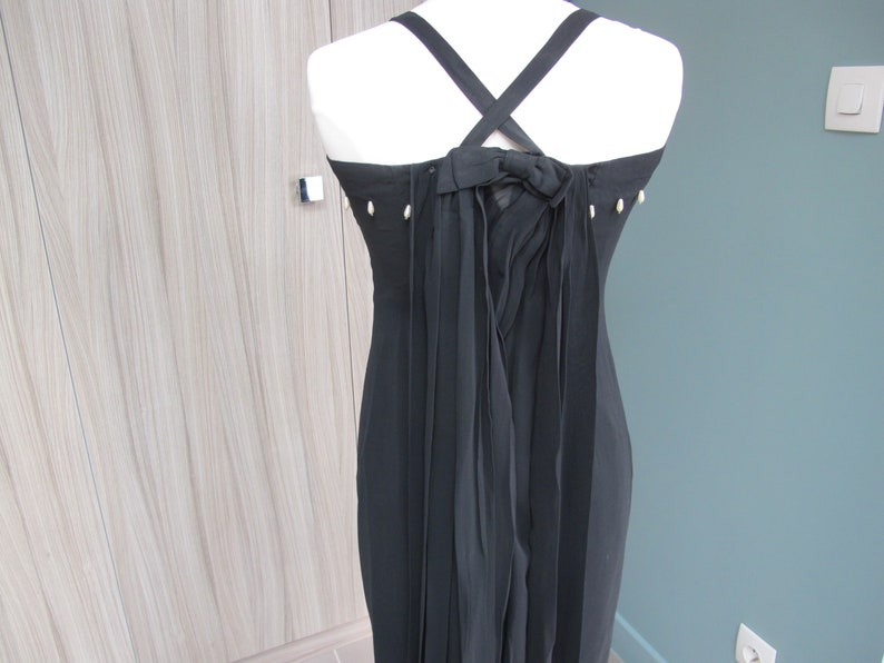 Maxi dress long evening dress in black crepe with small beads and long knot-like drags in the back