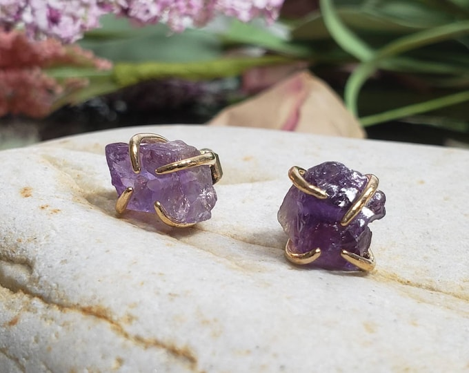 Raw Amethyst Stud Earrings with gold four prong harness.