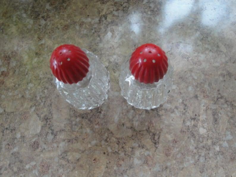 Red Celluloid Top Zipper Pattern Salt And Pepper Shaker Set