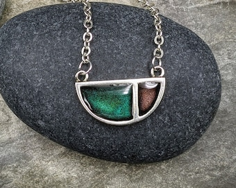 Deep turquoise green and plum, antique silver geometric pendant on antique silver chain.