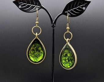 Translucent, metallic shades of green, antique bronze, teardrop shaped earrings. One of a kind. Fun and lightweight.