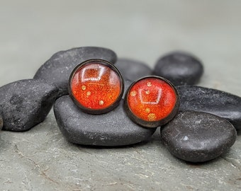 Small antique bronze and metallic deep orange red stud earrings, one-of-a-kind alcohol ink colored stud earrings. Rustic studs.