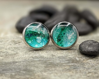 Glowing blue green stud earrings, small sparkle studs, one-of-a-kind alcohol ink colored stud earrings. Silver and light blue green studs.