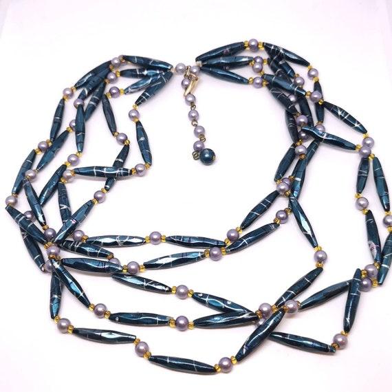1950s Festooning multistrand necklace. Long plasti