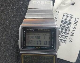 8b4c03f33 Very Rare NOS Vintage Casio DBC-610 WR Lcd Data Bank calculator watch