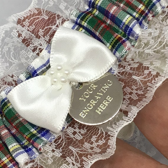 Wedding garter trimmed with lace and bow. Personalised Frazer tartan garter with engraved charm