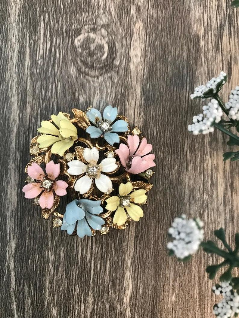 vintage metal flower pin with rhinestones