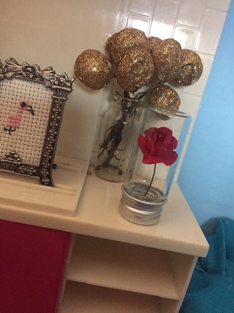 Miniature rose in a bottle