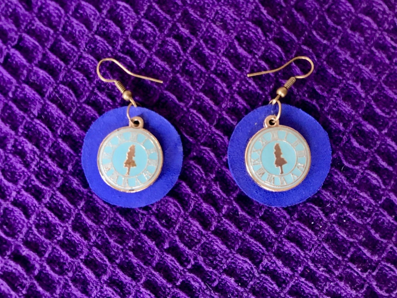 Round blue leather earrings with Alice in Wonderland charm; nickel free