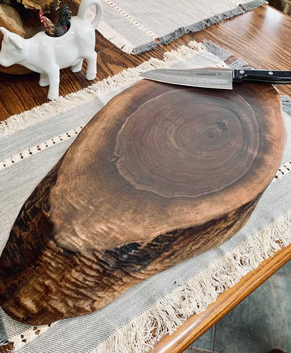 Bartop or Countertop Live Edge Black Walnut Cutting Board. One solid piece of hardwood for long life of the board and your knife. Made in Pa