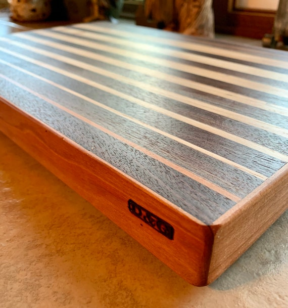 Medium size cutting board. Face grain hardwoods for long life of the board and your knife. For the Chef in Your House!    #11-A