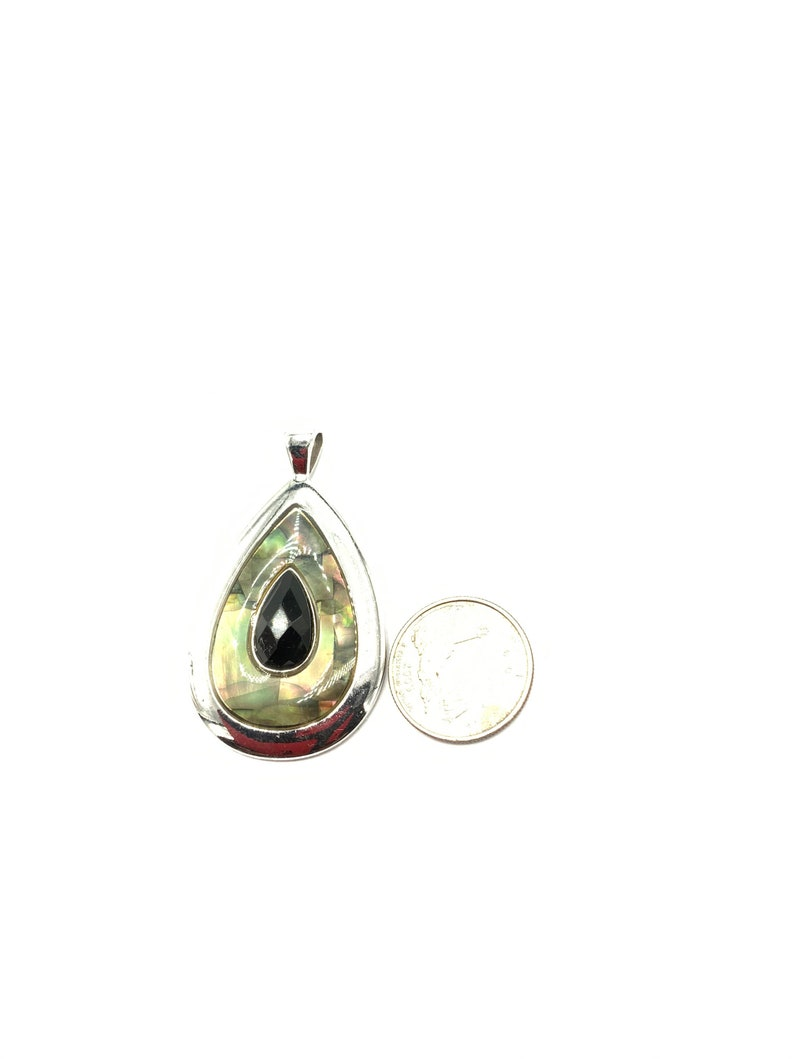 Gorgeous collectible teardrop pendant with abalone and black crystal by Lia Sophia and silver tone.