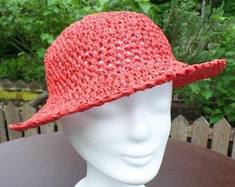 Elegant crocheted sun hat made of bast red