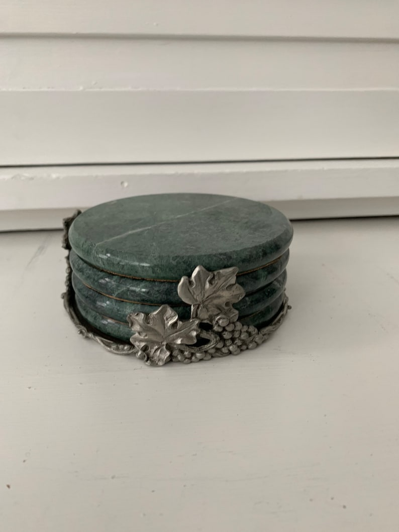 Vintage Seagull Pewter and marble grape pattern coaster set.