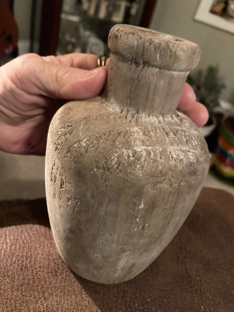 Wood bottle,very old \u201clooking\u201d,excellent condition,measures 6.5\u201dH,base is 2.75x3\u201d,12\u201d circumference