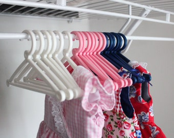 Plastic Doll hangers for 18 inch doll clothes. Sets in white, pink or dark blue. Doll wardrobe accessories.