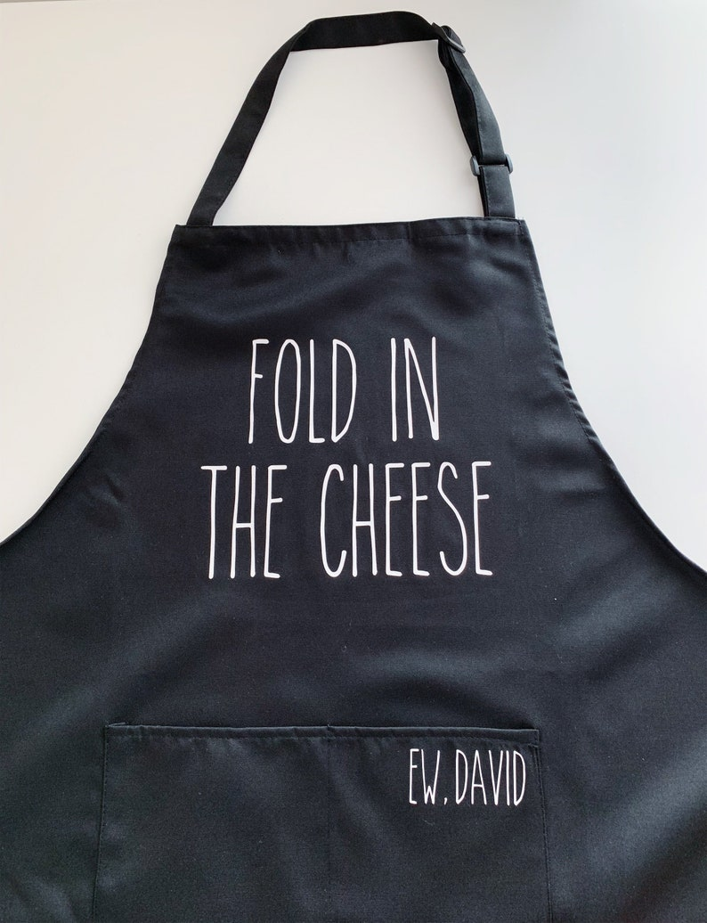 Top 27 Best Schitt's Creek Gifts from Etsy featured by top Seattle lifestyle blogger, Marcie in Mommyland: Fold In The Cheese Apron David and Moira Rose image 0