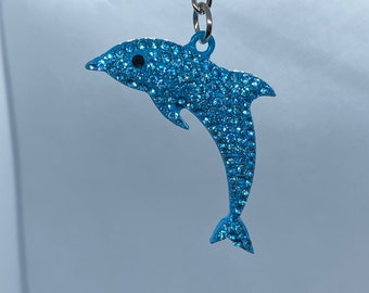 Jewelry making craft supply. Silver tone base metal dolphin pendant with rhinestones for DIY projects