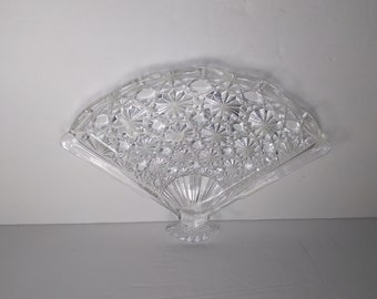 Vintage 1970s jewelry tray or trinket dish, Avon Fan Shape Glass Tray in Button and Daisy pattern