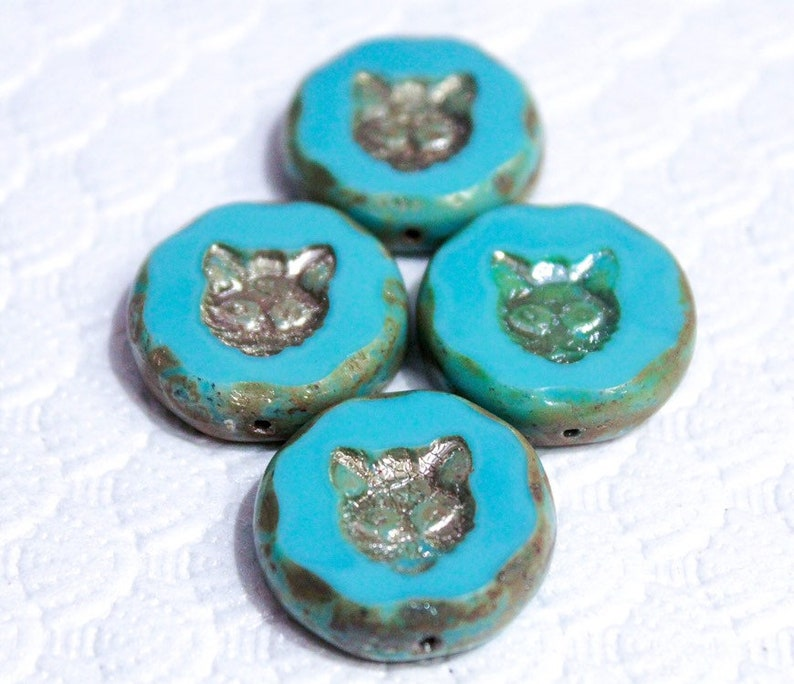 quantity 1 bead Sale...Hello kitty Opaque turquoise cat etched blue czech glass beads size 24mm