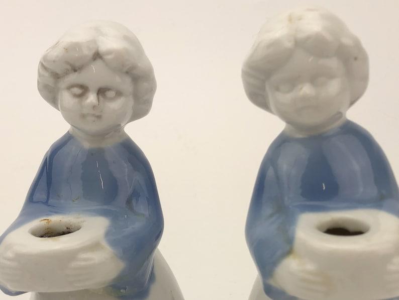 Porcelain set of two women holding bowls Christmas decor