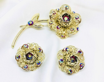 """Sarah Coventry """"Fashion Flower"""" Brooch and Clip Earrings Demi Parure, AB Rhinestones, Filigree Goldtone Flowers, 1960s"""