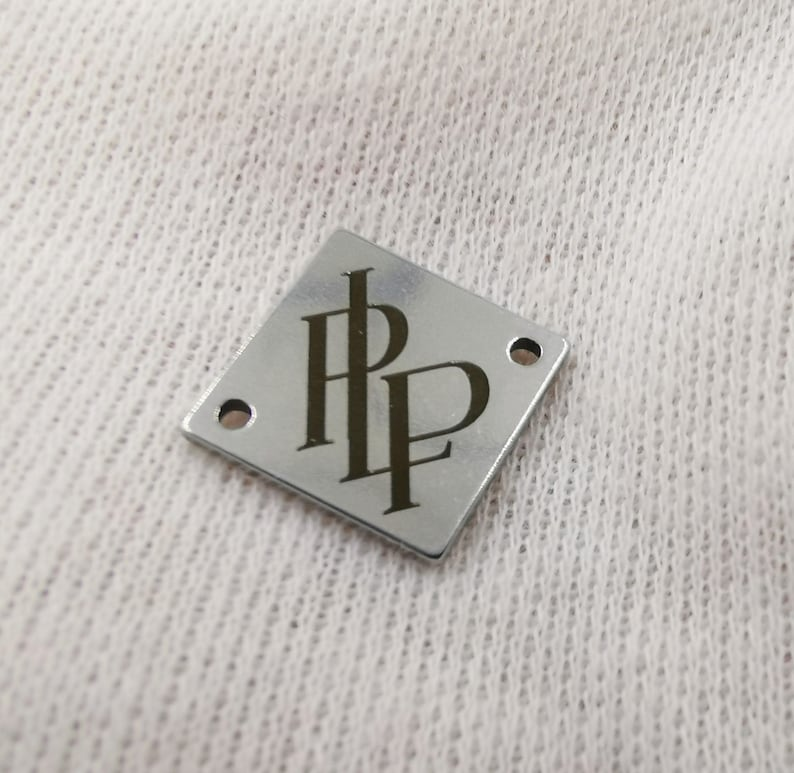 with your logo. 12 mm Square Metal tags 0.5