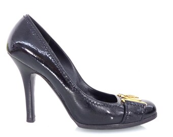 796ffc2e57c Gucci Hysteria black leather shoes heels