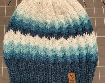 Handmade knitted beanie slouchy in blue ombre shades.